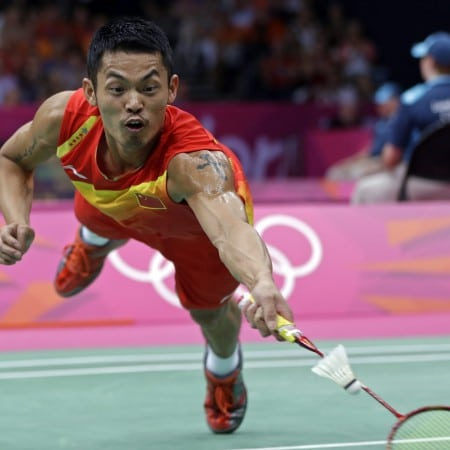 China's Lin Dan dives for a return while playing against Sho Sasaki, of Japan, in a men's singles badminton quarterfinal match at the 2012 Summer Olympics, Thursday, Aug. 2, 2012, in London. (AP Photo/Andres Leighton)